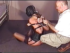 trussed corseted woman in..