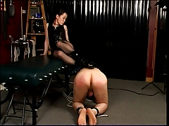 Dominatrix steps on his..